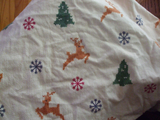 An old flannel sheet featuring reindeer and pine trees is a great source for ornament fabric.