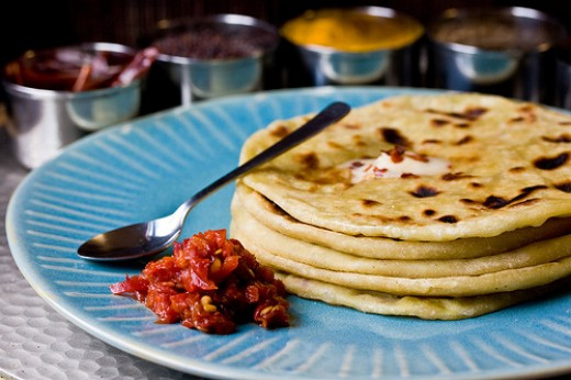 Indian paranthas with spices and curry
