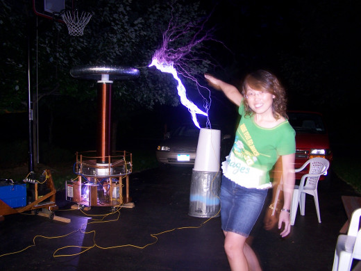 cute girl and Tesla coil