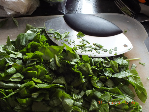 No need to cook the spinach first, just chop it small.