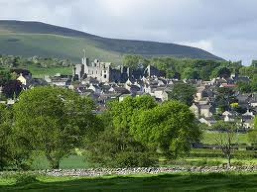 Middleham from the north-east with the castle behind the town