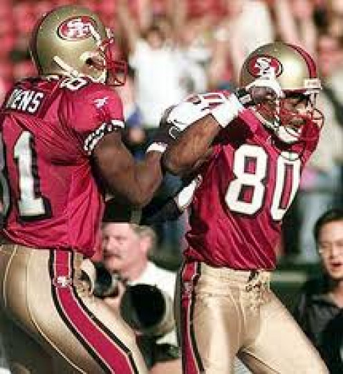 Jerry Rice with Terrell Owens showing off after a touchdown play. He made catches that looked impossible to handle.