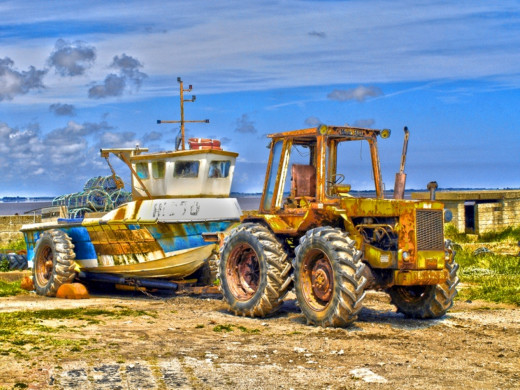 A disused boat and it's tugging tractor taken at Spurn Point in Yorkshire.