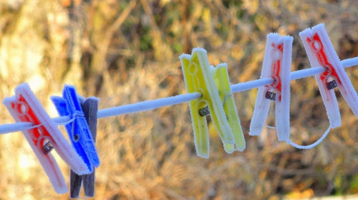 Frost covered clothes pegs on the washing line in our garden.