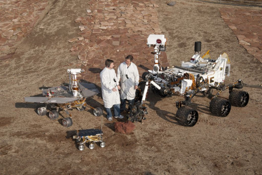 "Mars Pathfinder, aka Sojourner, the ""robot skateboard,"" landed on Mars in 1997 to see if we could drive a robot vehicle on another world. Spirit/Opportunity are the model at left, and have been roving Mars since 2004. Curiosity, right, lands in 2012."