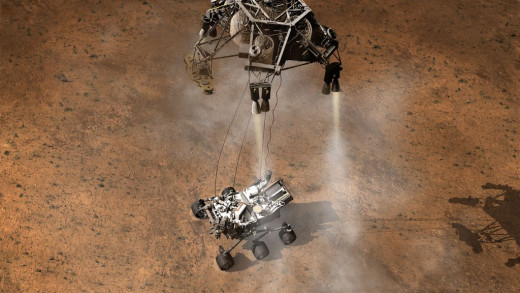 "Artist's concept of a rocket-powered ""sky crane"" dropping the Curiosity Rover onto the surface. This  has never been attempted before."