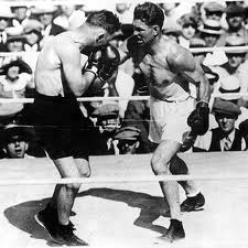 Jack Dempsey was a ruthless puncher and the former heavyweight champion of the world.  He drew the first ever million dollar gate in boxing.