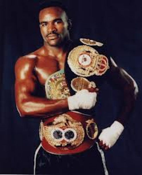 Evander Holyfield is the only four time heavyweight champion in boxing History.  He took on all comers and never ducked a challenger.