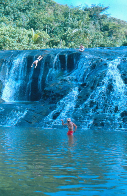The second falls from below, showing the pool (where Duncan was diving) and the river below. Ya, that's me in the hat.