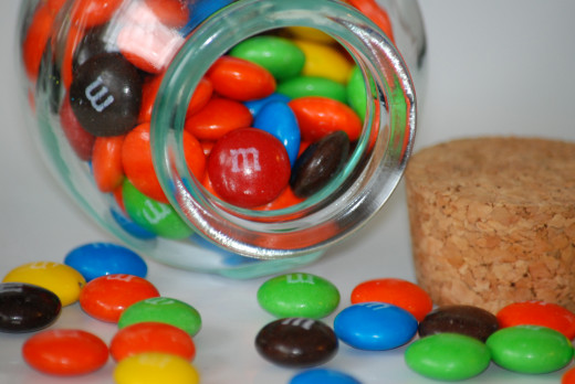 Still bored? Fill empty jars with candy, spill them on the table and count them one by one.