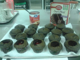 The chocolate cupcakes stuffed with the cherries.