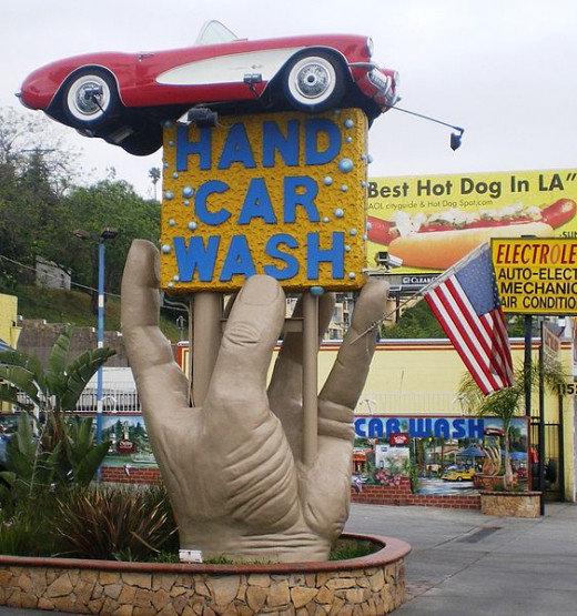 Certainly a one of a kind sign advertising car wash services by hand