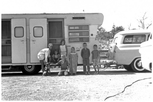This is the 'Draggin Wagon' trailer a couple years before the trip and the Dodge. L to R. Linda, Kim, Me kneeling, Nancy behind me, Diane Heimann, Steve Heimann and Jimmy