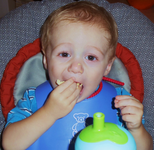Owen, by far the picker eater out of my two boys, enjoying some spinach and potato frittata