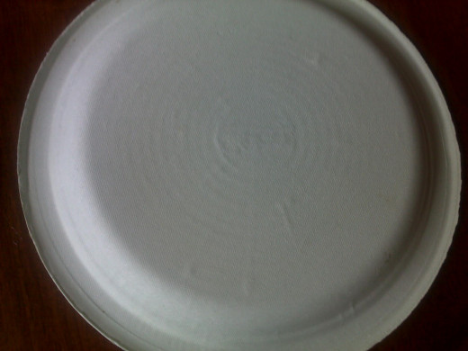 Start with a plain paper plate and follow the steps to draw a mummy face