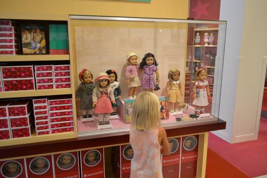 Daughter admiring American Girl dolls at Tysons Corner