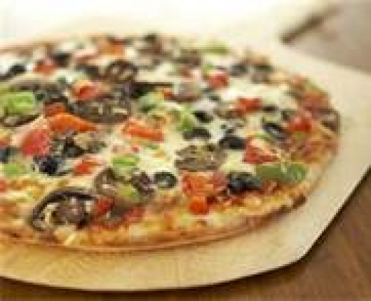 Veggie Pizza Add sautéed spinach, peppers, onions and mushrooms to a cheese pizza and you have a healthy meal.