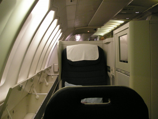 There is ample storage space in the upper bins as well as the panelling under the windows