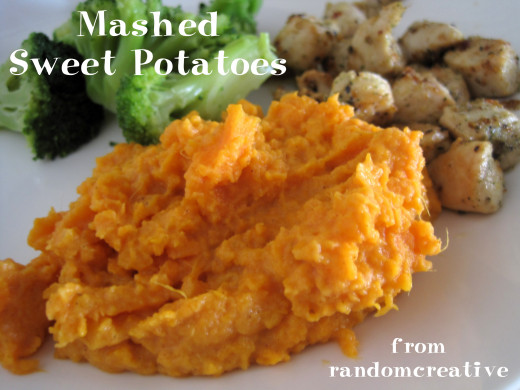 Mashed sweet potatoes with chicken and broccoli.