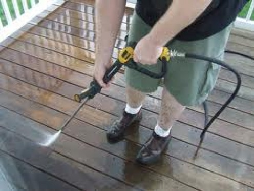 Power washing a deck requires a tip that omits light pressure so that the wood does not get split and splinter off.