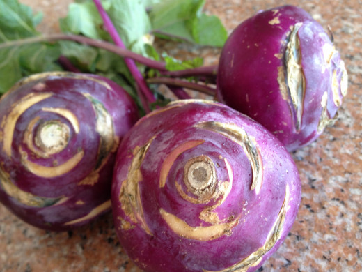 These purple bulbs charmed their way into my shopping cart.  Kohlrabi comes in both purple and green varieties.