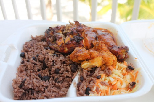 Jerk Chicken Leg Quarter, Beans and Rice, Coleslaw and a bit of Grilled Fish for $6US.  Absolutely delicious regardless of price.