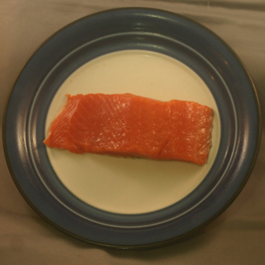 Slice from a Sockeye Salmon fillet. You can use Coho, and it can be raw, cooked, or smoked. Smoked salmon is called lox.