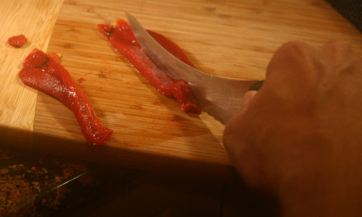 Slicing the pepper into strips is fun and easy. 8 strips will make a nice star on your omelet.