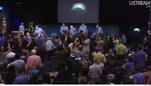 EDL team, latest thumbnail photo from Curiosity on Mars landing site in background.