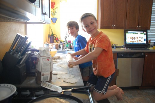 D and his helper happily making tortillas