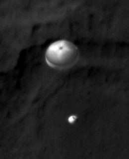 [Update Aug 6, 2012] HIRES camera of Mars Reconnaissance Orbiter, an older spacecraft that's been studying Mars from space for years, managed to capture photo of Curiosity's descent stage!!!! (Sent in Aug 6, about 9AM PDT)