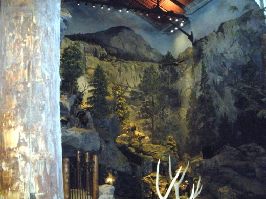 Looking across the store from upper level at the mural surrounding the waterfall and fish tank