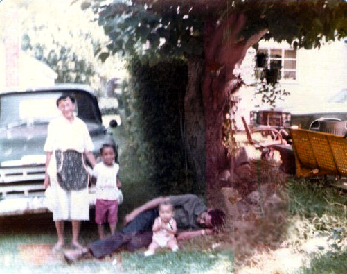 Simpler Times: Big Mama posing in front of the old truck, with yellow swing at right.