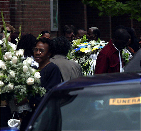 The coffin of 9-year-old Donte Manning is carried from Shiloh Baptist Church after the boy's 2005 funeral. Donte was shot in Columbia Heights. Photo Credit: By Dudley M. Brooks -- The Washington Post