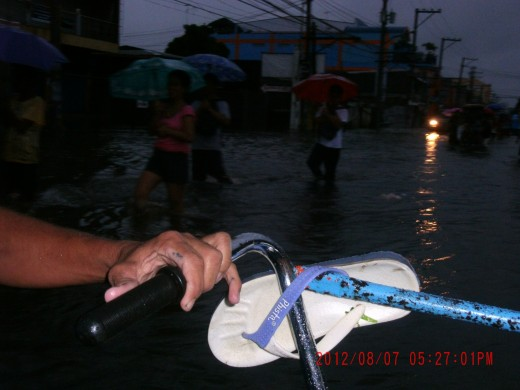 While inside the wheeler, I was also taking pictures of those who were wading in knee-deep flooded main road in the City of San Fernando.