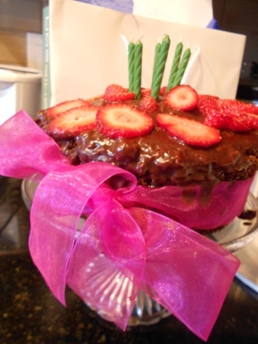 Pour over chocolate topping and decorate  with fruit as desired.