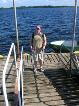 Me on the dock at Lamanai holding Belikin beer.