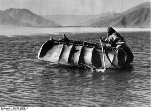 Coracle made with bent wood frame covered in a Yak skin (in Tibet)
