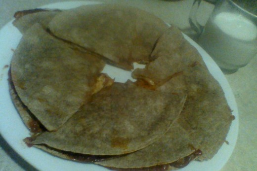 """""""Pizzadillas"""" make a delicious, light dinner, especially when paired with a mug full of milk. A dollop of ricotta cheese could be added to the middle of this circle, for a dippable garnish."""