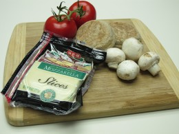 Ingredients for one serving:  English muffin, mozzarella cheese, tomato and fresh mushrooms.