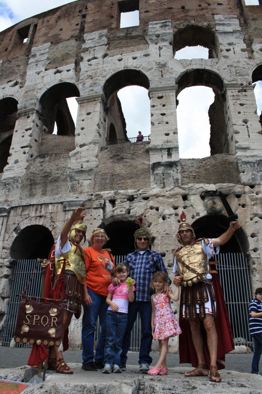 Getting their pictures taken with the Gladiators in front of The Roman Coliseum