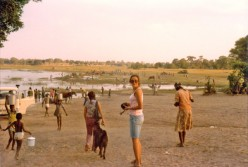Gathering Water in Botswana (1975) - Women and girls carried heavy buckets filled with water on their heads.