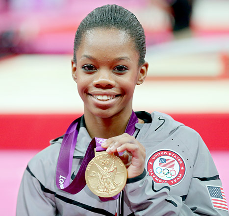 Gabrielle Douglas proudly showing her Olympic Gold Medal for Individual Gynastics