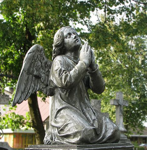 Statue of angel on cemetery in Bielsk Podlaski, Poland