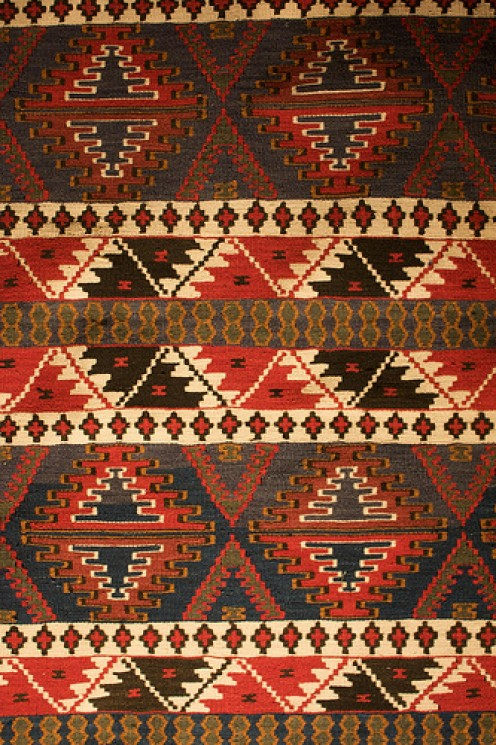 An intricate Kilim rug will add warmth and color.