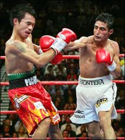 Erik Morales popping Manny Pacquiao In their first bout. Morales won one out of three. Paquiao won the last two fights by knockout.