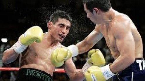 Marco Antonio Barrera tags Erik Morales in their third encounter. Barrera won two out of the three contests.