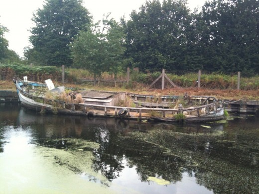 An abandoned boat at Sankey Valley, England's oldest canal.  Photo © Redberry Sky 2012.