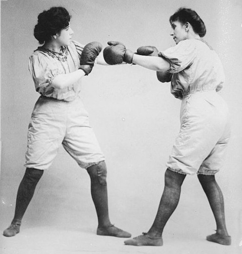 """Bennett Sisters"" boxing bout around 1910 in the USA. Female boxing was illegal in UK until 1996. In Summer 2012, women boxed in the UK and won medals for their performances."
