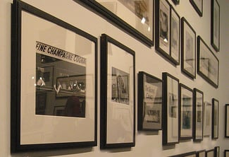 A grouping of framed black and white photography would be suitable wall art for a home office.